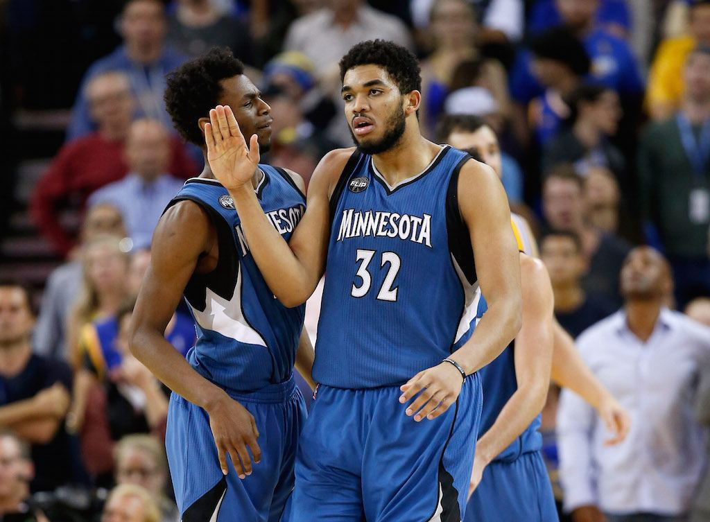 Karl-Anthony Towns #32 of the Minnesota Timberwolves is congratulated by Andrew Wiggins #22.