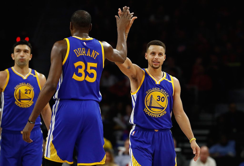 Stephen Curry #30 of the Golden State Warriors celebrates a second half basket with Kevin Durant #35