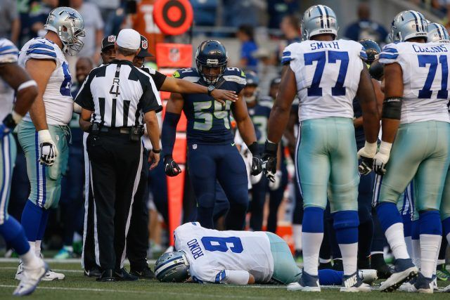 Tony Romo lies on the turf after getting injured.