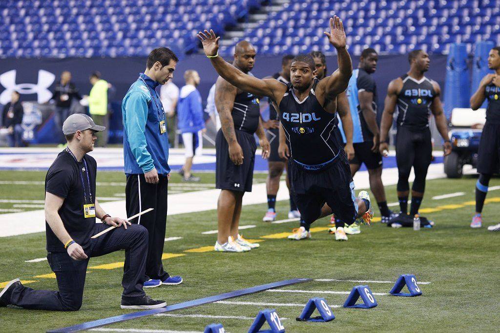 Former Missouri defensive lineman Michael Sam takes part in the broad jump during the 2014 NFL Combine.