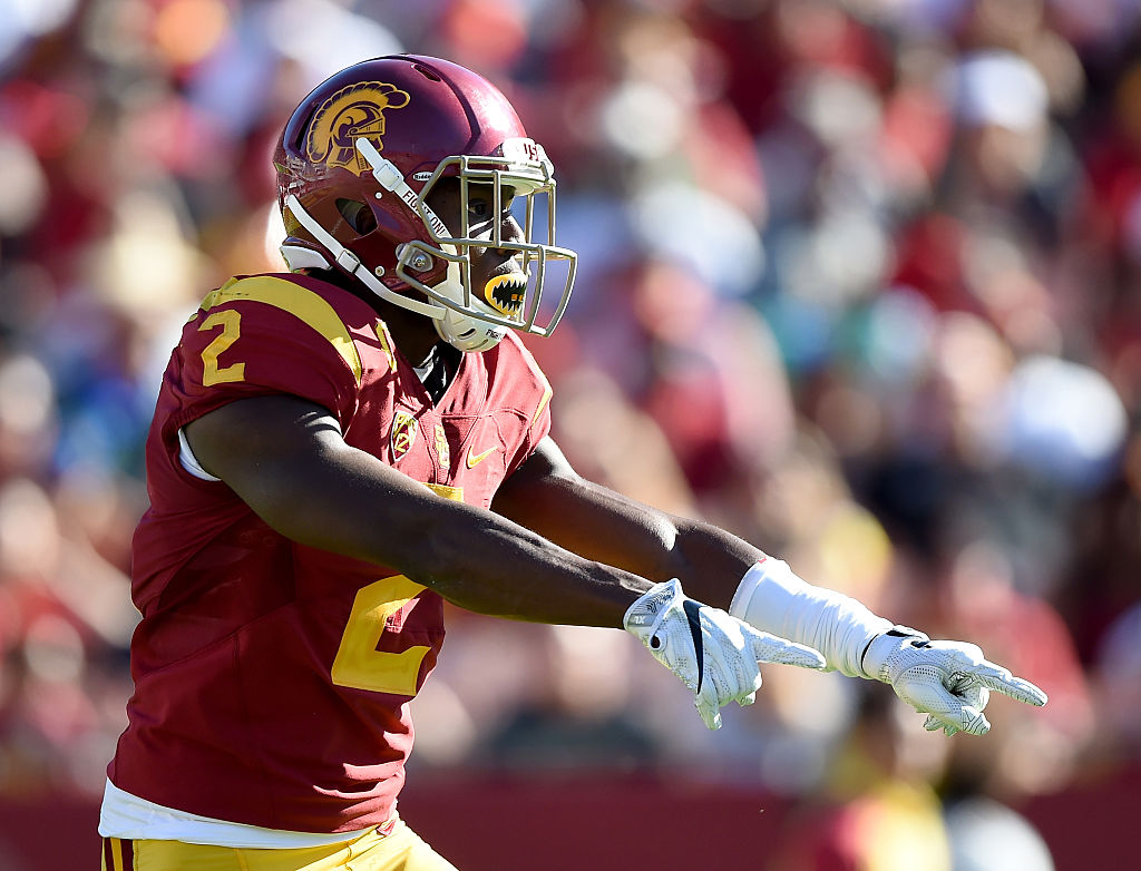 Adoree' Jackson of the USC Trojans reacts during a punt return.