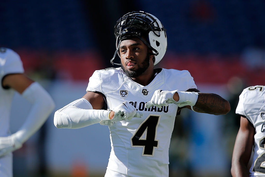 Chidobe Awuzie of the Colorado Buffaloes warms up prior to facing the Colorado State Rams.
