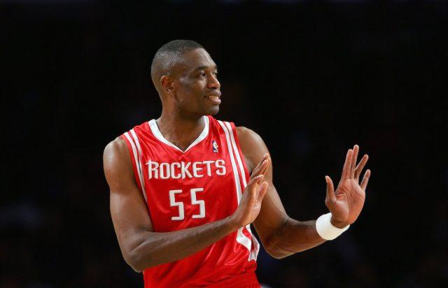 Dikembe Mutombo gestures during the game.