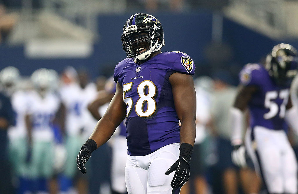 Elvis Dumervil of the Baltimore Ravens reacts during a game.