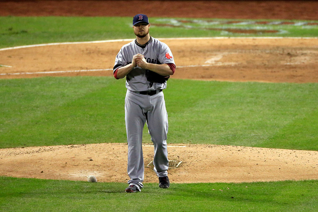Jon Lester of the Boston Red Sox holds his arm as he is removed from Game 5 of the 2013 World Series.