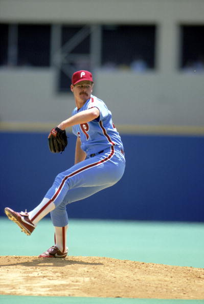 Kevin Gross of the Philadelphia Phillies winds back to pitch.