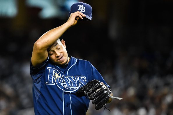 Joel Peralta of the Tampa Bay Rays wipes his forehead.