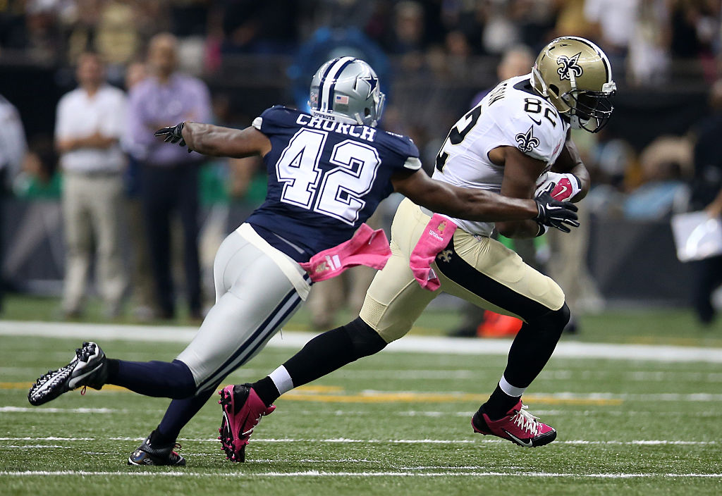 Benjamin Watson of the New Orleans Saints carries the ball as Barry Church of the Dallas Cowboys defends.