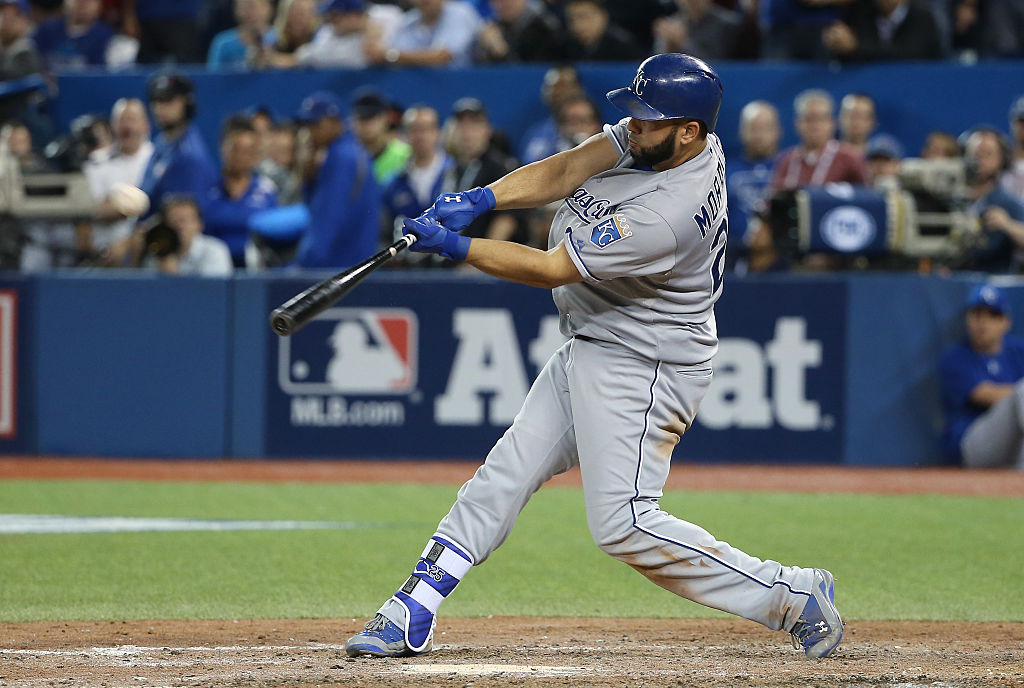 Kendrys Morales of the Kansas City Royals hits a two-run home run.