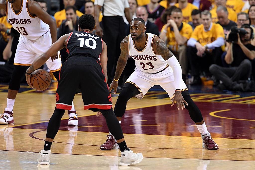 LeBron James defends DeMar DeRozan of the Toronto Raptors.