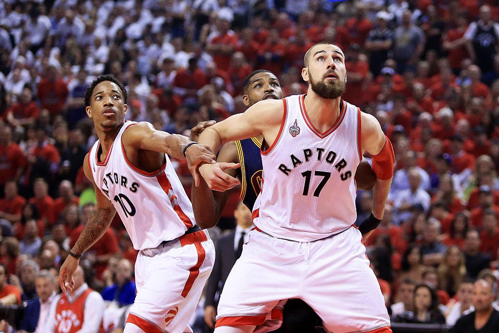 Jonas Valanciunas and DeMar DeRozan of the Toronto Raptors look to rebound against Tristan Thompson of the Cleveland Cavaliers.