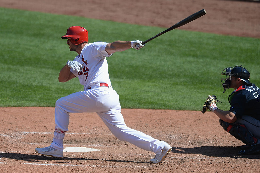 Matt Holliday of the St. Louis Cardinals hits a single.