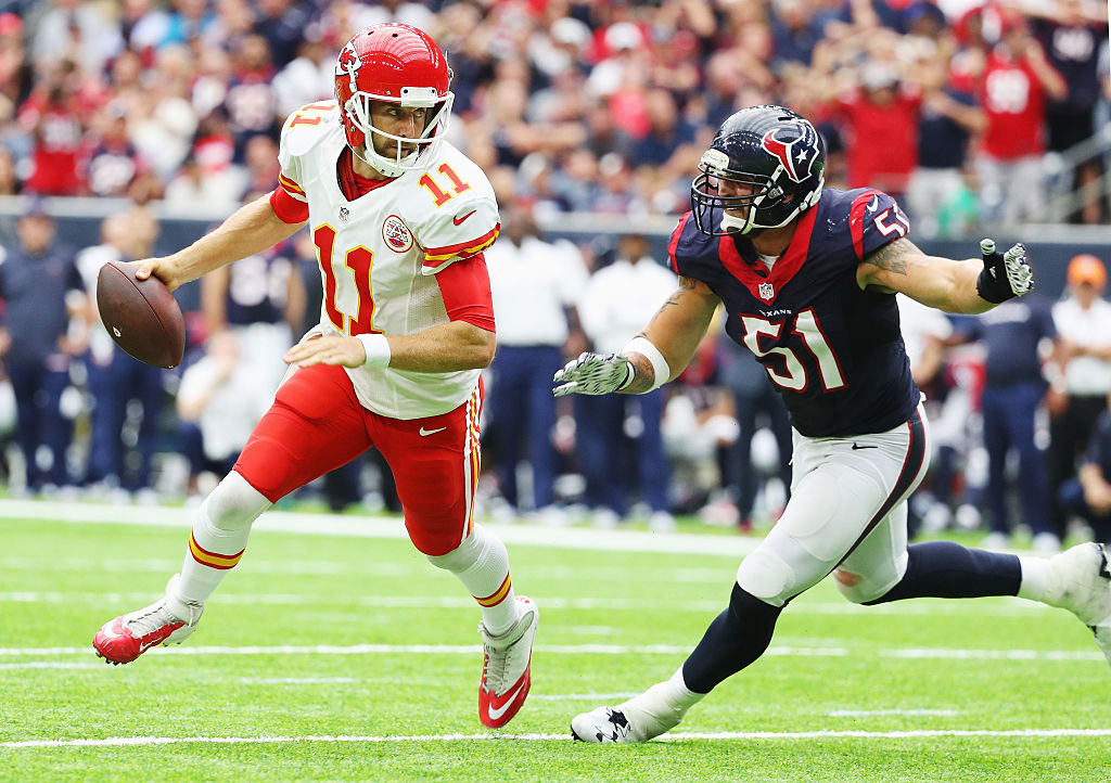 John Simon of the Houston Texans pursues Alex Smith of the Kansas City Chiefs