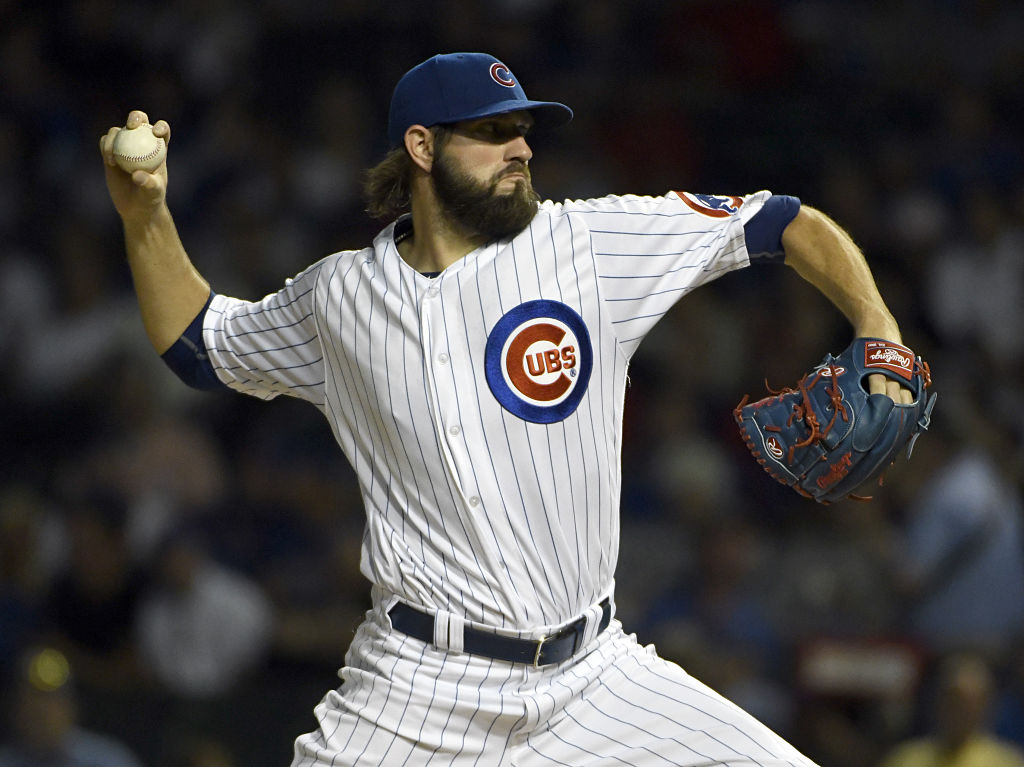 Jason Hammel of the Chicago Cubs throws against the Cincinnati Red.