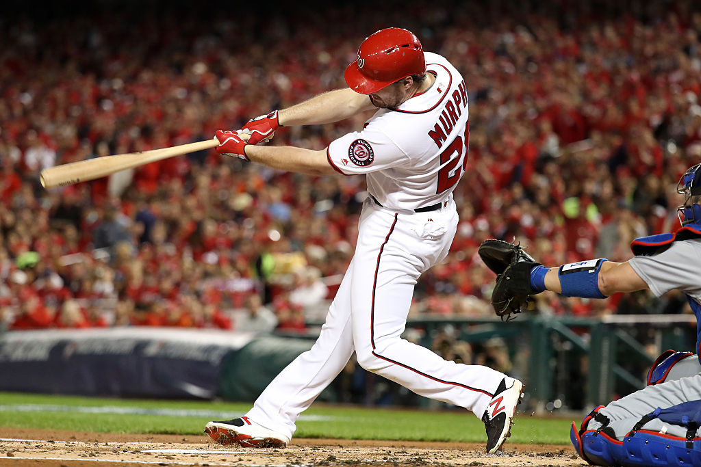 Daniel Murphy of the Washington Nationals hits a single in the second inning.