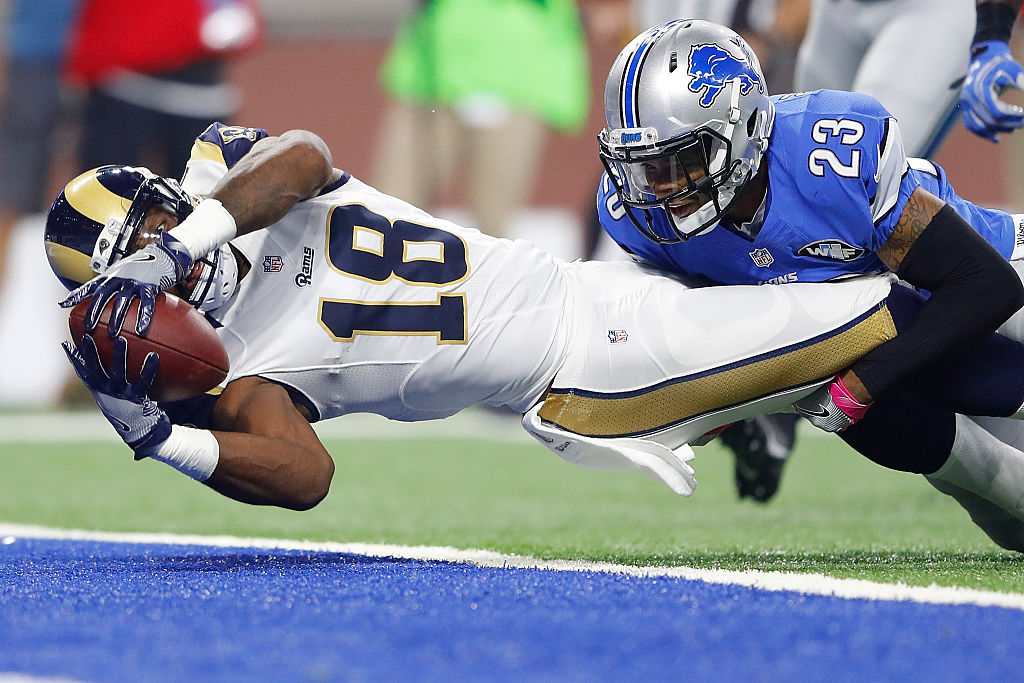 Kenny Britt of the Los Angeles Rams stretches out over the goal line for a touchdown