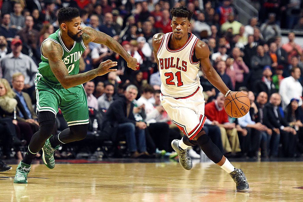 Jimmy Butler of the Chicago Bulls drives to the basket against Amir Johnson of the Boston Celtics.