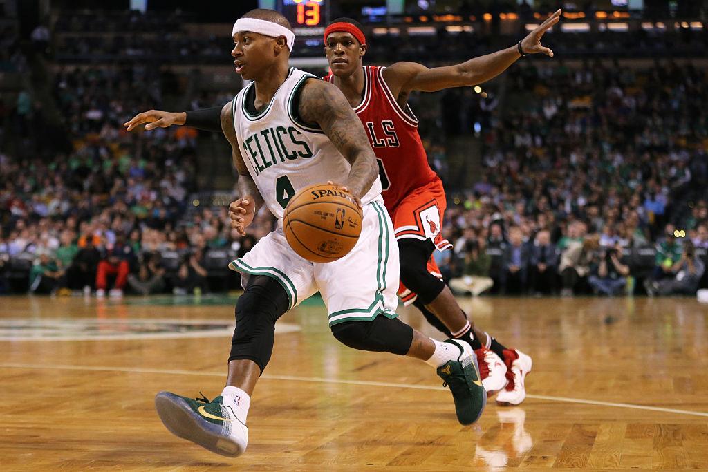 Isaiah Thomas of the Boston Celtics drives against Rajon Rondo of the Chicago Bulls.