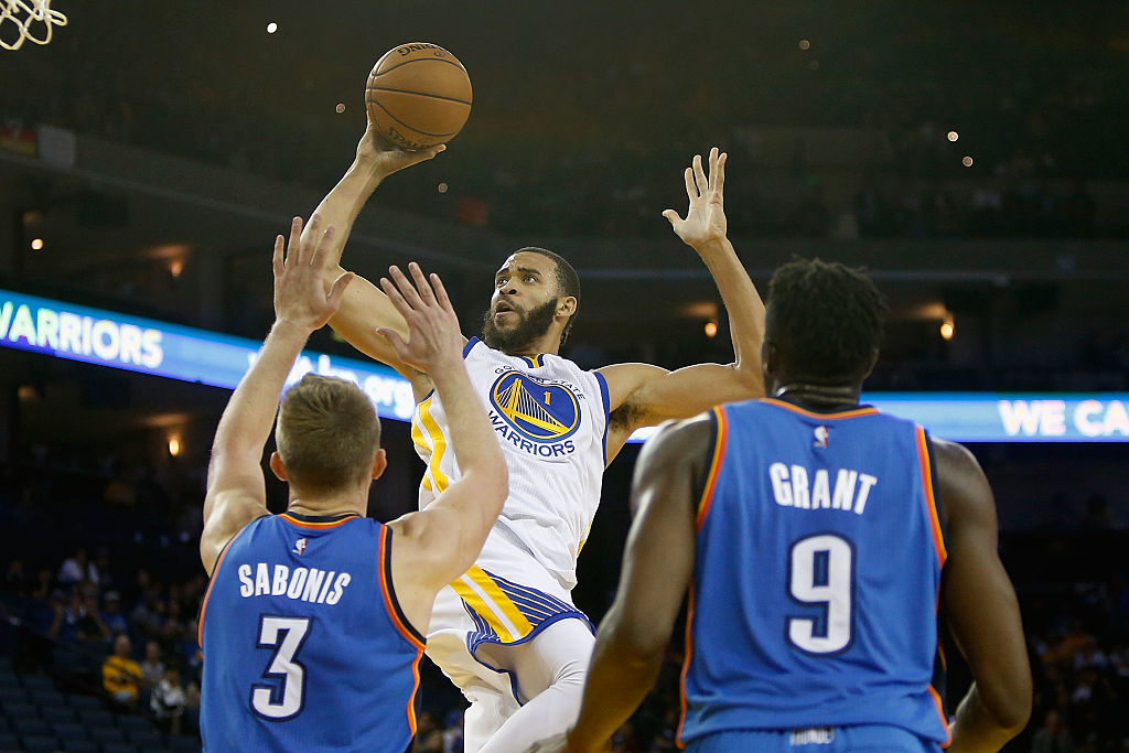 JaVale McGee of the Golden State Warriors goes to the basket against the Oklahoma City Thunder defense.