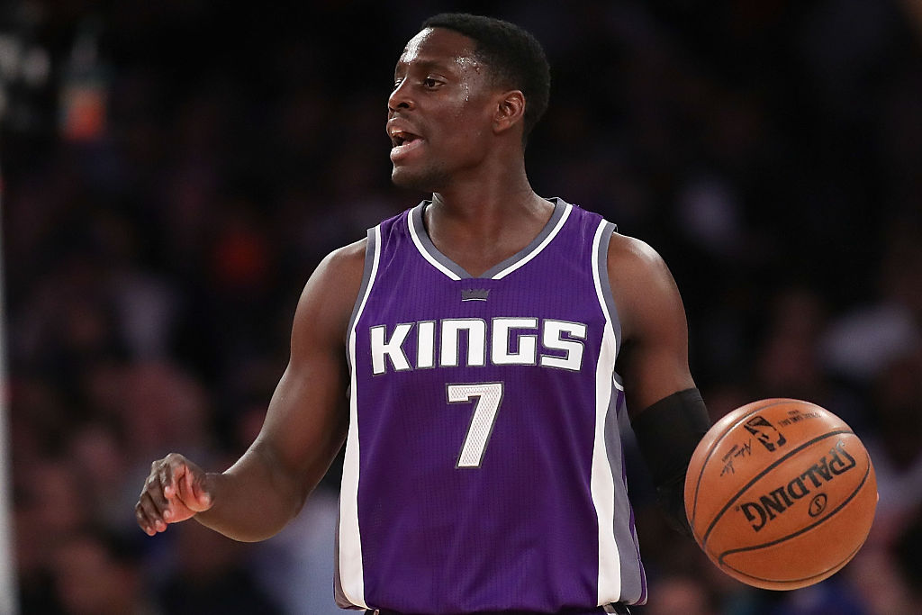 Darren Collison of the Sacramento Kings dribbles up court against the New York Knicks.