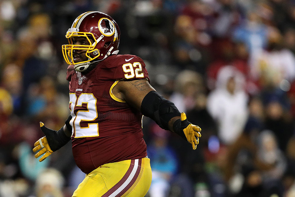 Defensive end Chris Baker of the Washington Redskins reacts after sacking quarterback Cam Newton