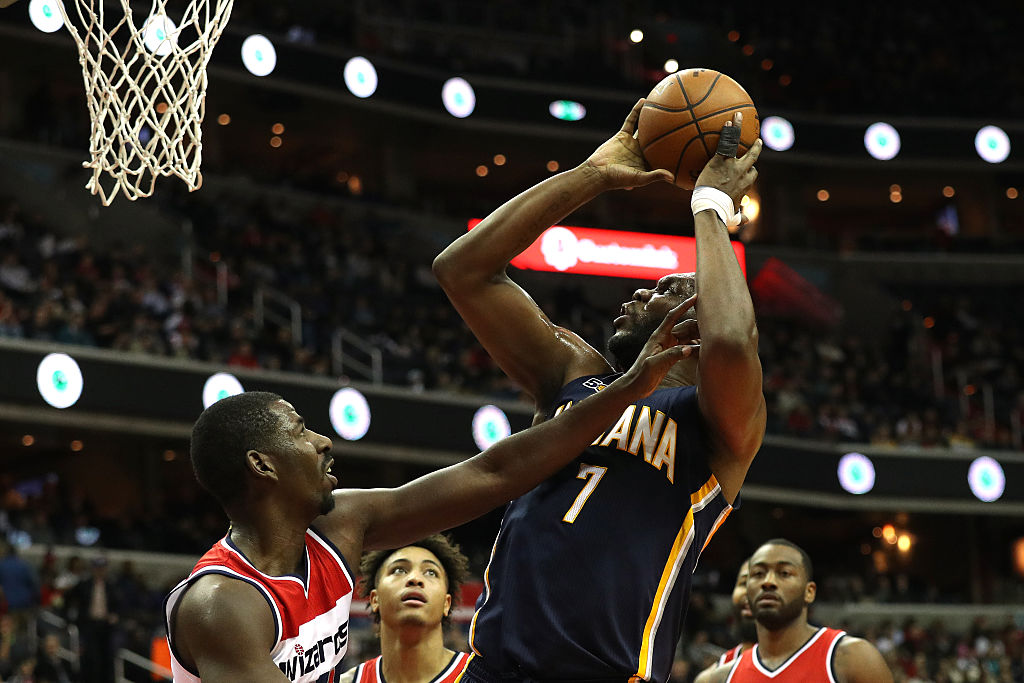 Al Jefferson of the Indiana Pacers shoots in front of Andrew Nicholson of the Washington Wizards.