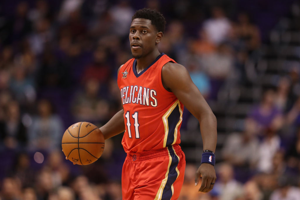 New Orleans' Jrue Holiday dribbles toward the basket.