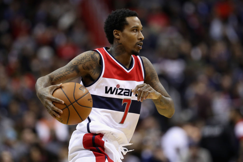 Brandon Jennings runs toward the basket.