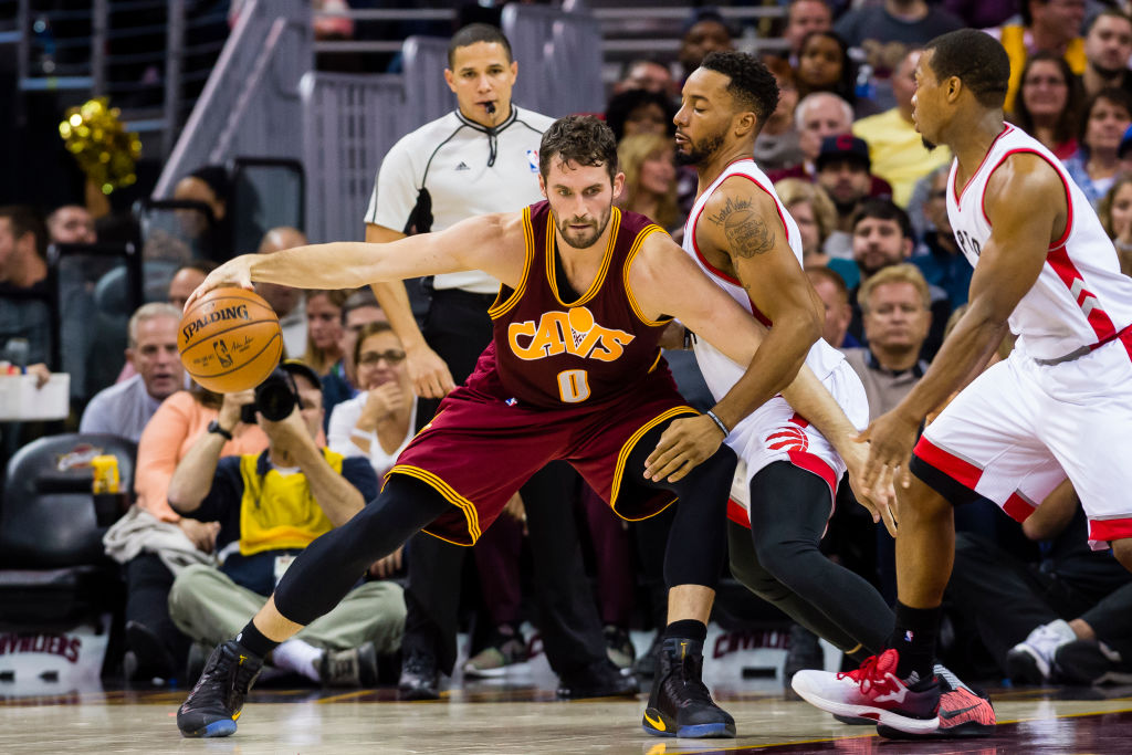Kevin Love of the Cleveland Cavaliers posts up Norman Powell of the Toronto Raptors.
