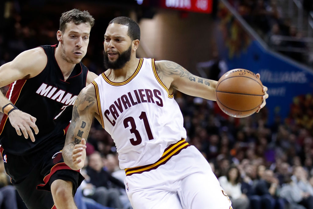 Deron Williams of the Cleveland Cavaliers drives around Goran Dragic of the Miami Heat.
