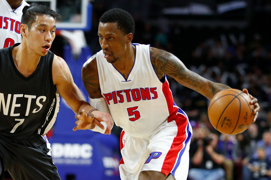 Kentavious Caldwell-Pope of the Detroit Pistons drives around Jeremy Lin of the Brooklyn Nets.