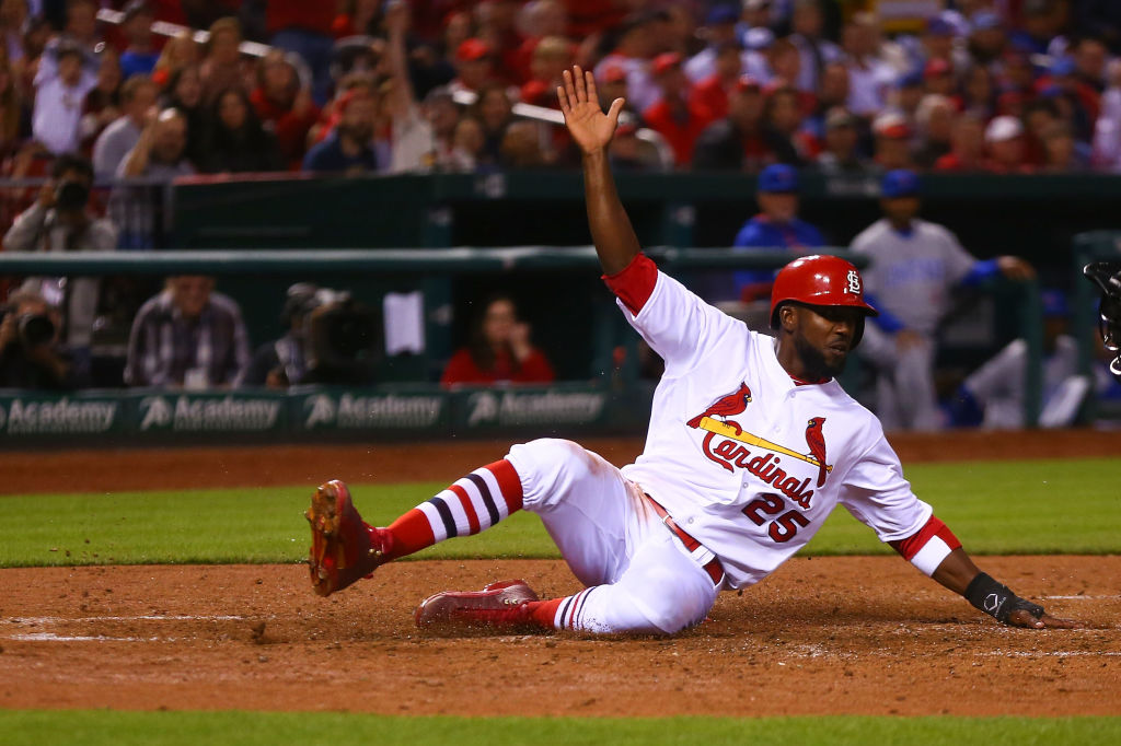 Dexter Fowler of the St. Louis Cardinals scores a run against the Chicago Cubs.