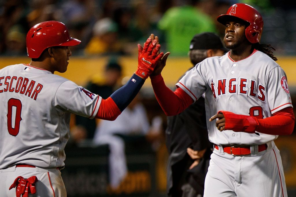 Cameron Maybin high fives his teammate.