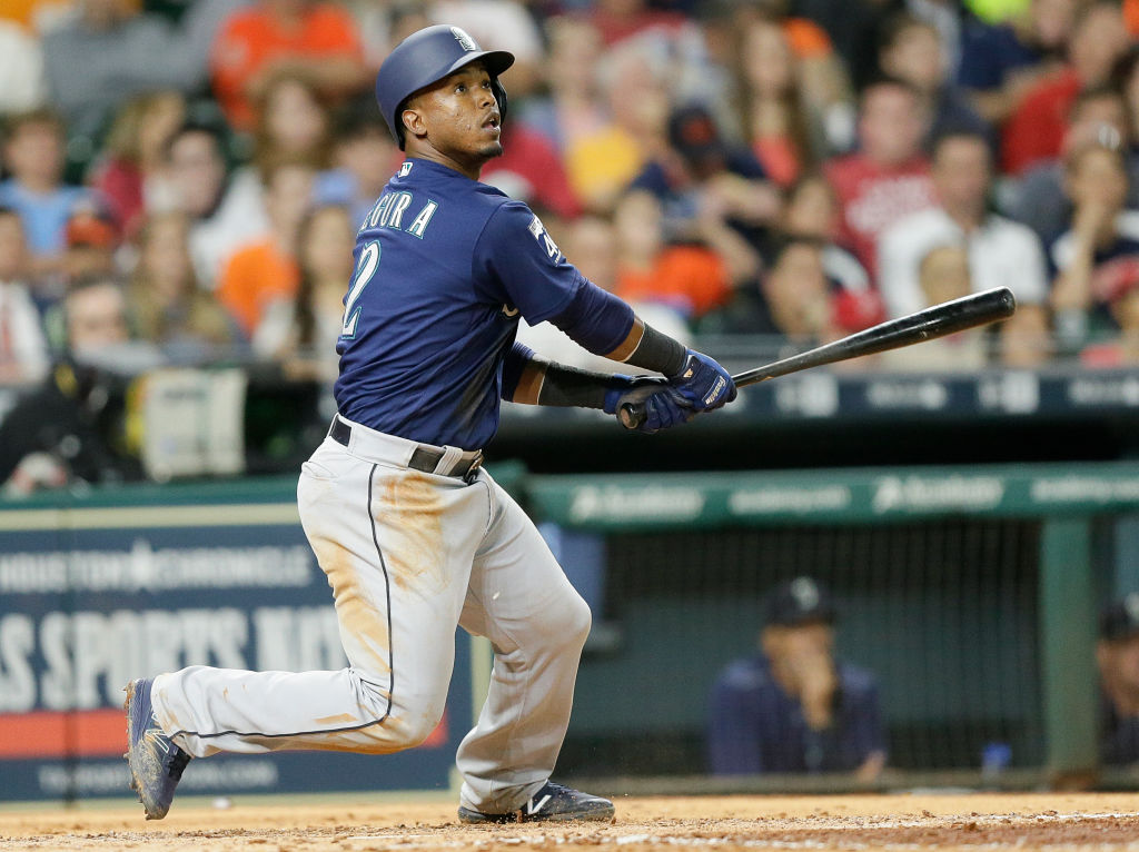 Jean Segura of the Seattle Mariners hits a two-run home run against the Houston Astros.