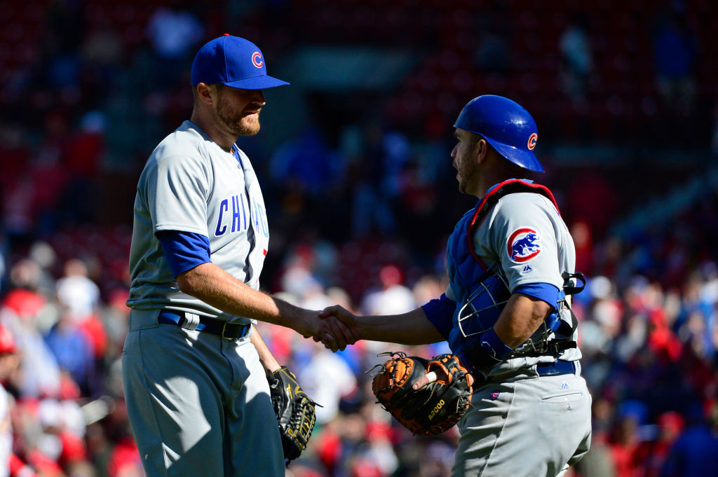 Wade Davis of the Chicago Cubs celebrates with Miguel Montero after closing out the ninth inning against the St. Louis Cardinals.