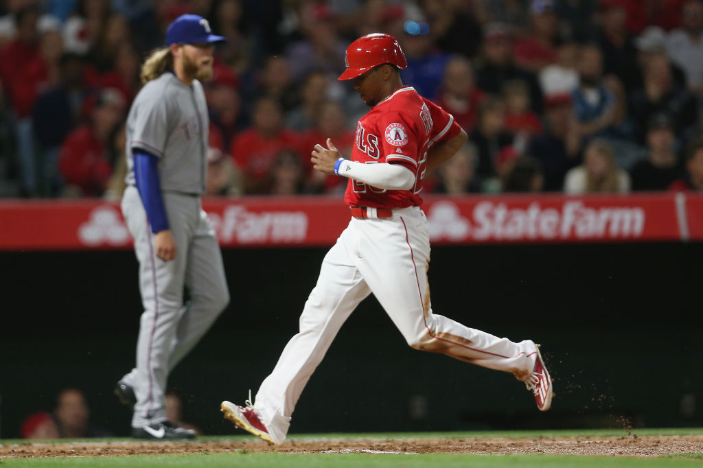 Ben Revere of the Los Angeles Angels of Anaheim crosses home plate.