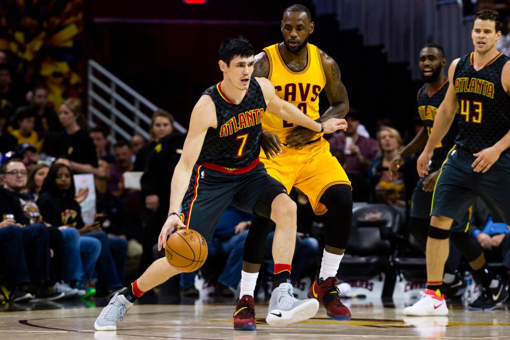 Ersan Ilyasova of the Atlanta Hawks drives around LeBron James of the Cleveland Cavaliers.