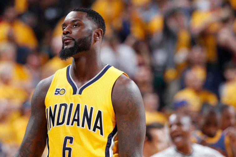 The Pacers' Lance Stephenson stands on the court.