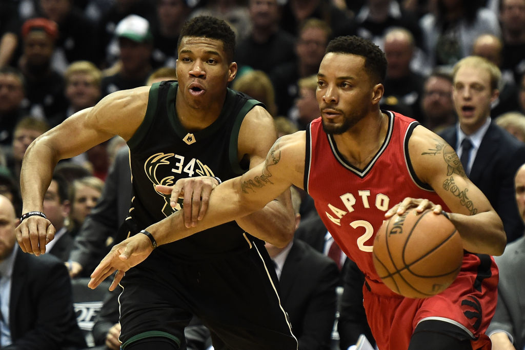 Norman Powell of the Toronto Raptors drives to the basket against Giannis Antetokounmpo of the Milwaukee Bucks.