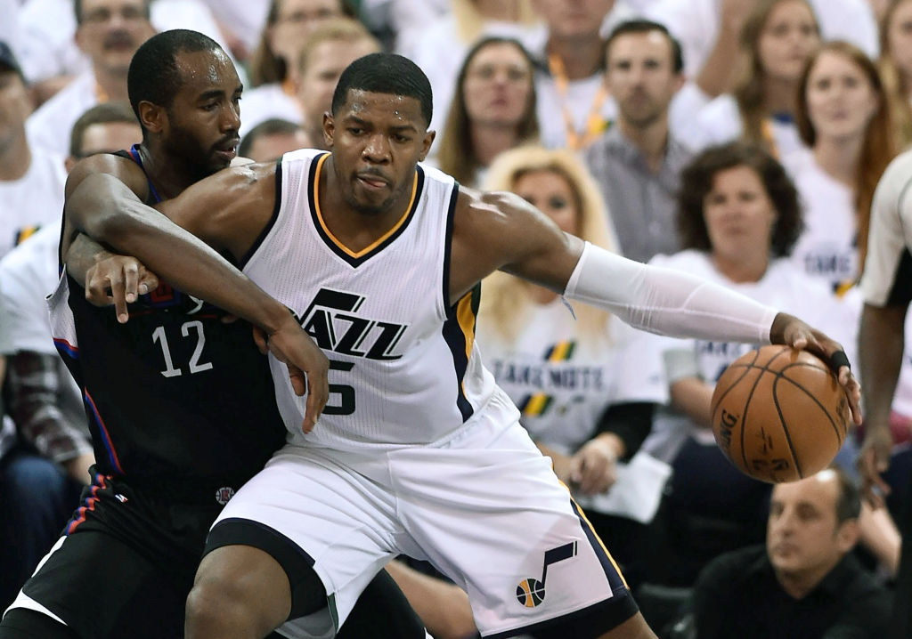 Joe Johnson of the Utah Jazz tries to drive past the defense of Luc Mbah a Moute.