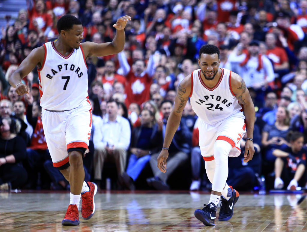 bb3ede3814f Norman Powell of the Toronto Raptors celebrates a dunk with Kyle Lowry.
