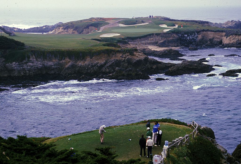 A golfer tees off during the Bing Crosby Pro-Am at Cypress Point Country Club.