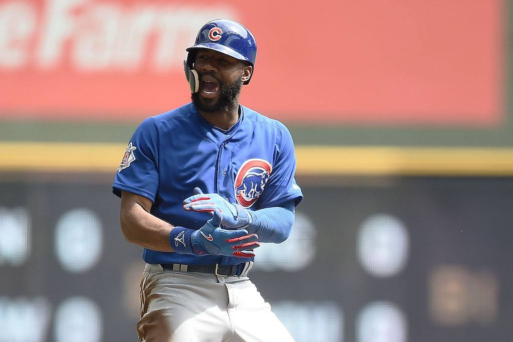 Jason Heyward celebrates hitting a triple.
