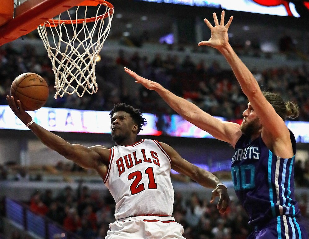 Jimmy Butler puts up a shot at the rim.