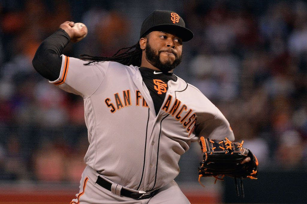 Johnny Cueto delivers the pitch.