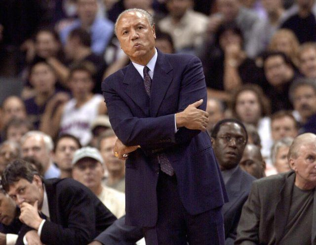 Lenny Wilkens looks on from the sidelines.