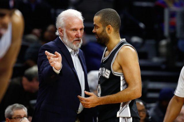 Head coach Gregg Popovic of the San Antonio Spurs talks to Tony Parker.