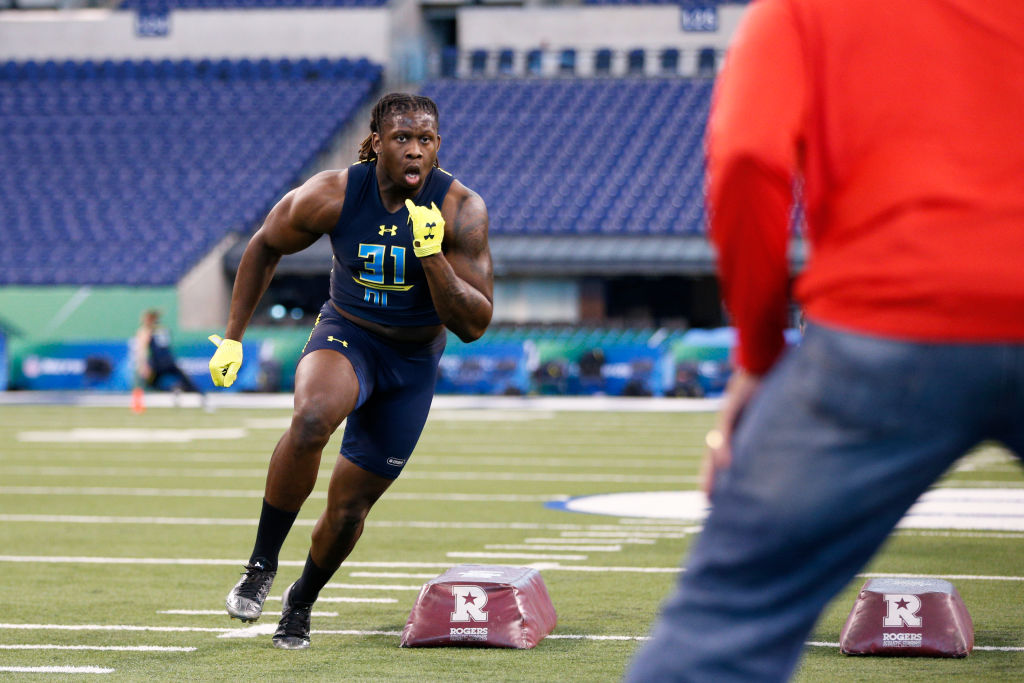 Defensive lineman Takkarist McKinley of UCLA participates in a drill during the NFL Combine.