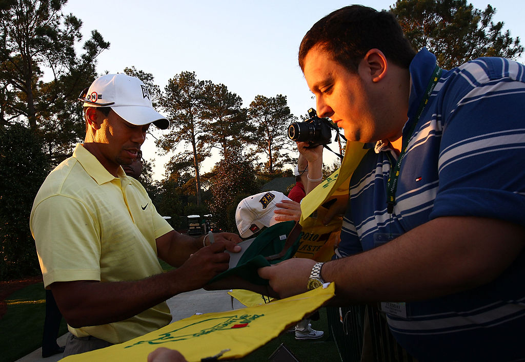 Tiger Woods signs autographs for fans prior to the 2010 Masters Tournament.