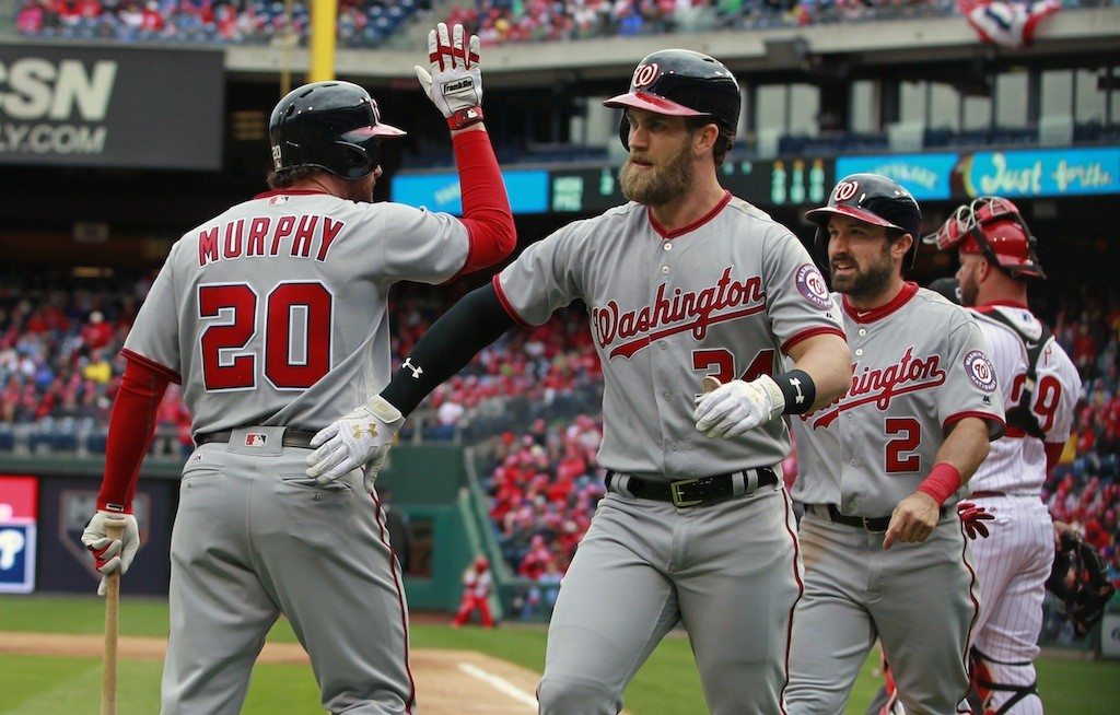 Bryce Harper high fives his teammate.